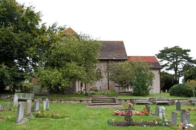 Graves in churchyard at St John the Baptist, Clayton (via geograph)