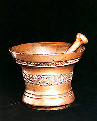 An apothecary's pestle and mortar from 1662 (via apothecaries.org)